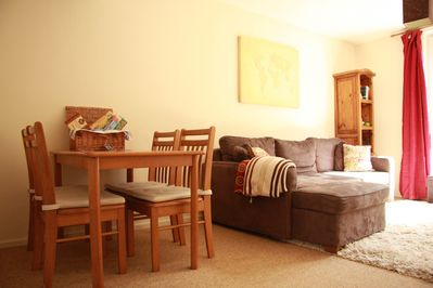 Large open plan dining/lounge room with large windows allowing plenty of light.