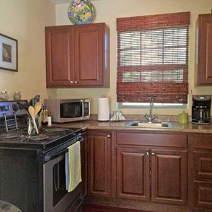 Kitchen includes microwave, oven/range, all dishes & cookware