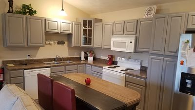 Kitchen features single serve coffee maker with a variety of coffees supplied.