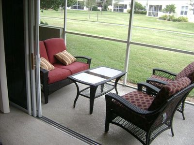 Lanai with triple doors opening from living room.  Unit opens onto park.