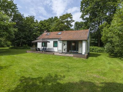 Photo for Cosy holiday home with sunny garden near the North-Sea beach of Vrouwenpolder