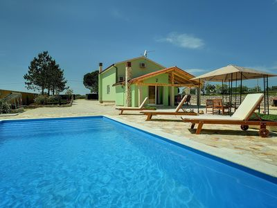 Photo for This 2-bedroom villa for up to 4 guests is located in Vodnjan and has a private swimming pool, air-c