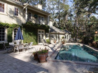 Photo for Walk to beach.  Stunning French Cottage with golf course view in Sea Pines--Ocean Green