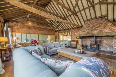 Ground floor: Large seating area with wood burning stove as the centre piece to the room