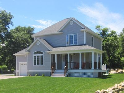 Photo for Newer East Beach home with water views, private beach parking  and much more