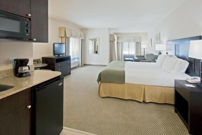 Unit with a King size bed and flat screen TV