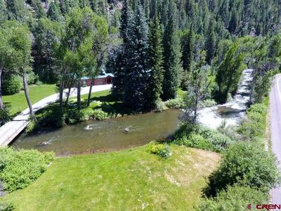 """Photo for """"Best of Durango"""" Secluded, 600 feet of riverfront, park-like setting"""