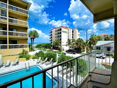Photo for Villas of Clearwater Beach 1B Overlooking the Pool with view of the Beach Too!