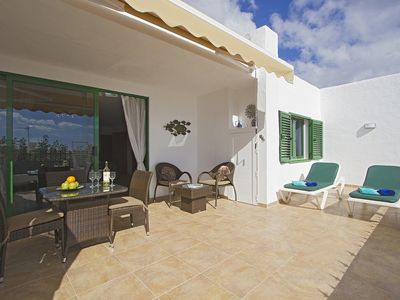 Photo for Luxury apartment, large private sun terrace, full UK TV, WiFi, immaculate pool.