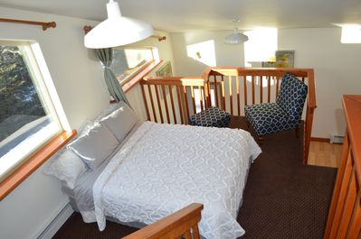 Queen Bed with sitting area, dresser open to below (no private bedroom) all open