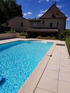 Photo for In SARLAT 900 m from the medieval town, pleasant house with swimming pool, large park.