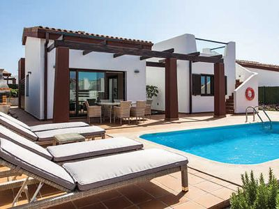 Photo for Modern, chic accommodation in walking distance to beach and golf.
