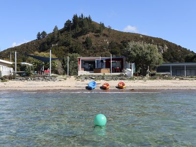 Photo for Paradise in Pataua. Absolute beach front bach with it all