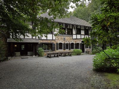 Photo for Stunning Ardennes castle villa with fireplace situated in a wooded area