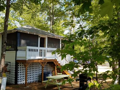 Photo for Adorable cottage set among tall pines with sandy beach a half mile from town.
