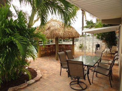 Photo for E. facing,Lil Piece of Paradise waterfront home,relaxing patio & tiki by water.
