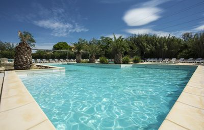 Photo for Cozy holiday home 7p in holiday park with large swimming pool in Arles, wifi, air conditioning