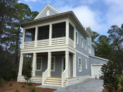 Photo for BRAND NEW beach house w/ golf cart. Backs up to huge forest. Walk to beach/pool.