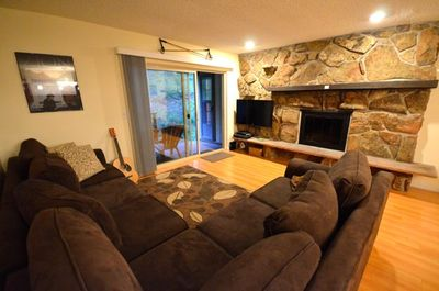 Living Room with Fireplace and TV.  There is free WiFi and Cable.
