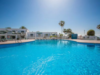 Photo for Modern Apartment Close to Beach with Pool, Stunning Sea Views & Terrace; Parking Available
