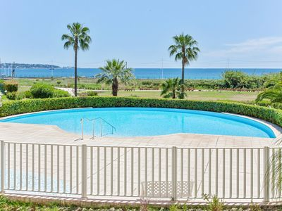 Photo for Bright apartment with swimming-pool in Juan-les-Pins/Antibes/Golfe-Juan