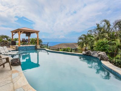 Photo for Panoramic ocean views. Oasis pool & hot tub.  2 miles from town
