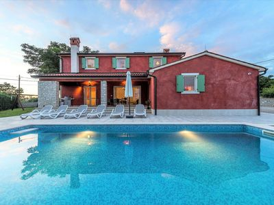 Photo for The villa surrounded by a beautiful garden with swimming pool