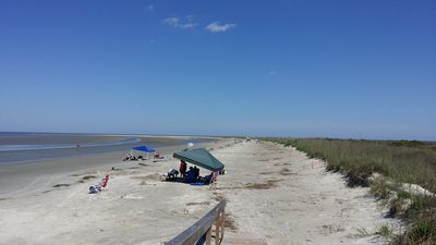 2.5 miles of unspoiled beach are just a 3-minute walk from your front door.
