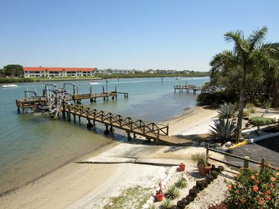 Unique waterfront setting with small beach and private fishing pier