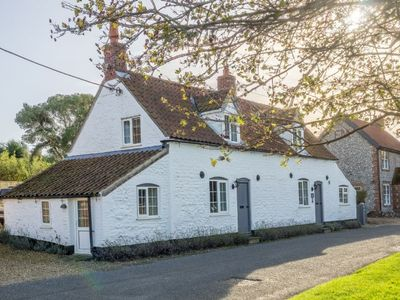 Photo for A spacious, traditional detached cottage with views over the saltmarshes