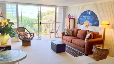 Living Room and Lanai (with table and chairs). Great for breakfast and sunsets!  Includes Sofabed, LCD TV, DVD, stereo, CD and wireless Internet.