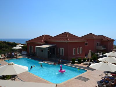 Photo for Sea view 2 bedroom apartments Skala, Kefalonia: green lawn, swimming pool, bar