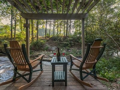 Photo for Private waterfall/swim hole, trout stream, hot tub, walk to Rumbling Bald Resort