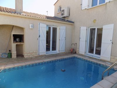 Photo for Stylish house with Mediterranean garden, barbecue, private pool and air conditioning