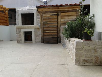 Photo for Apartment with barbecue, large terrace and separate entrance in quiet street