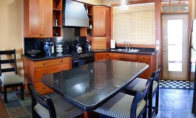 Executive Kitchen with Granite counters and convenient Island
