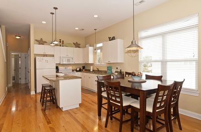 Dining and kitchen areas.