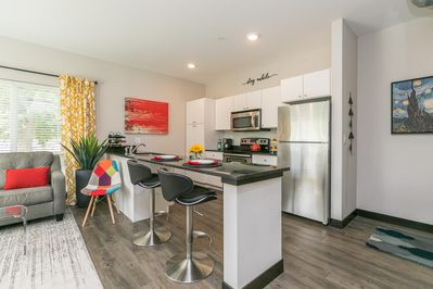 Spacious kitchen and seating area. FULLY STOCKED with dishwasher, oven, fridge