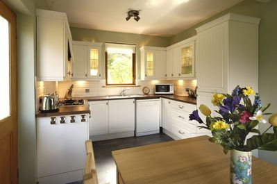 The spacious well equipped kitchen dining room has lovely views