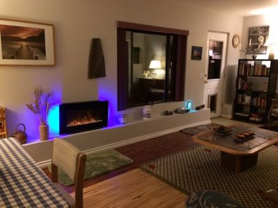 Living room at night with decorative wall-mounted heater