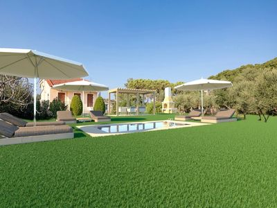 Photo for This 3-bedroom villa for up to 7 guests is located in Vasilikos and has a private swimming pool, air