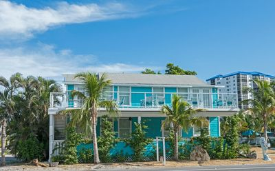 Photo for OCEANIC#1, MODERN 2BED ,PRIVATE PATIO,STEPS TO BEACH! WITH POOL!