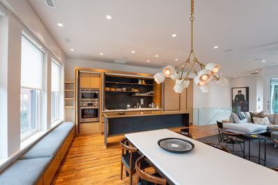 Kitchen and dining area over looking an active downtown three floors below