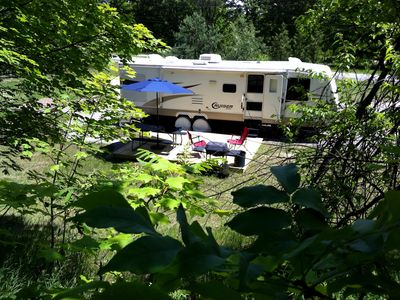 Photo for Private Caravan on beautiful 2.5 acre wooded setting close to village and beach