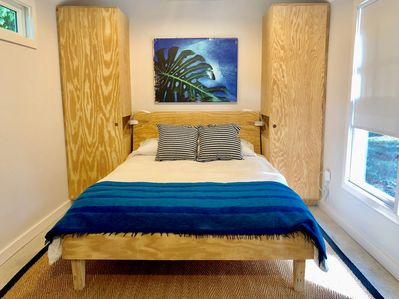 Queen bed with two closets