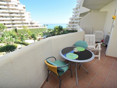 Photo for 1 Bedroom with sea views, pools, slides, walking distance to Beach! Sleeps 4.