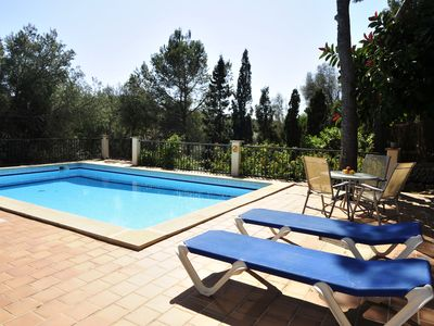 Photo for Holiday house with pool on a hillside, near the beach, in the fishing village of Porto Petro