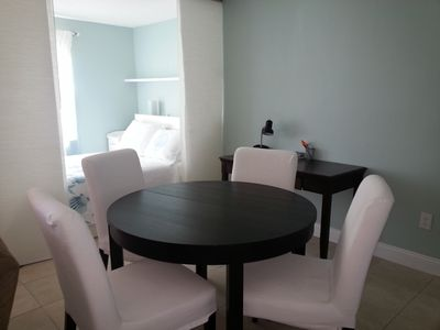 Dining area and double bed w/ privacy curtains