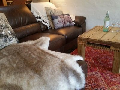 Leather lounge and Moroccan rug in winter.