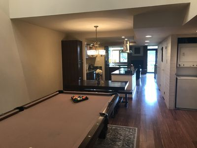 View from entry - gameroom, dining, kitchen and living room